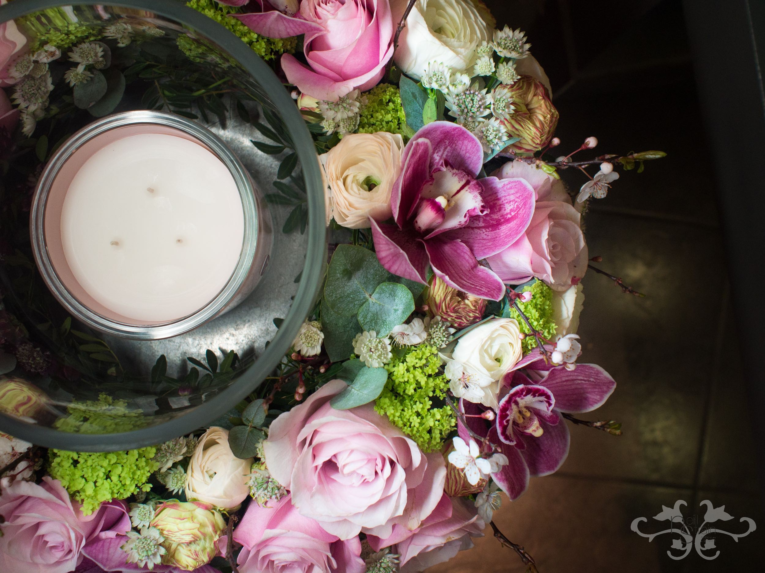Neill Strain floral wreath cradles a Rachel Vosper luxury candle