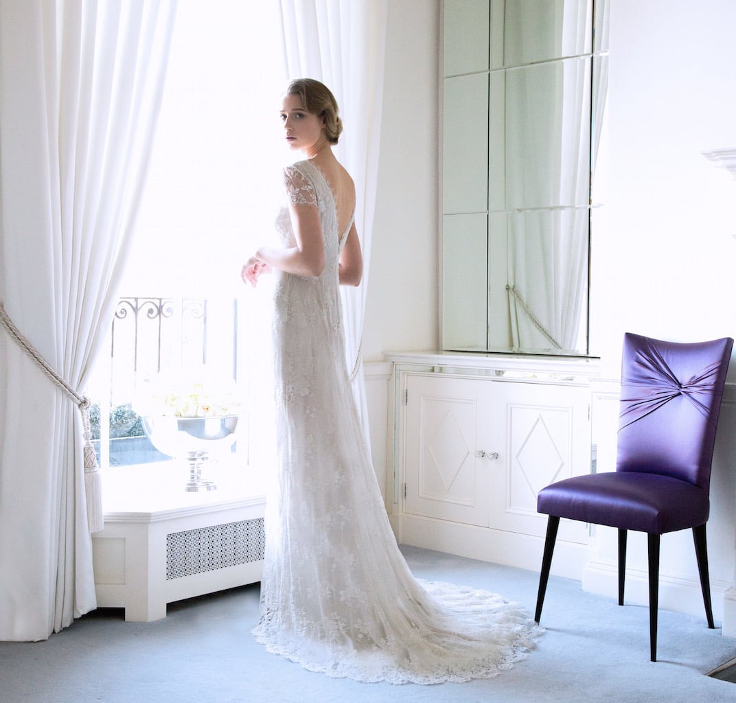 The 'Poppy' Fine Lace Bridal Gown with Scalloped Neckline €5995 suggests white Ranunculus with their many layers of fluffy petals.