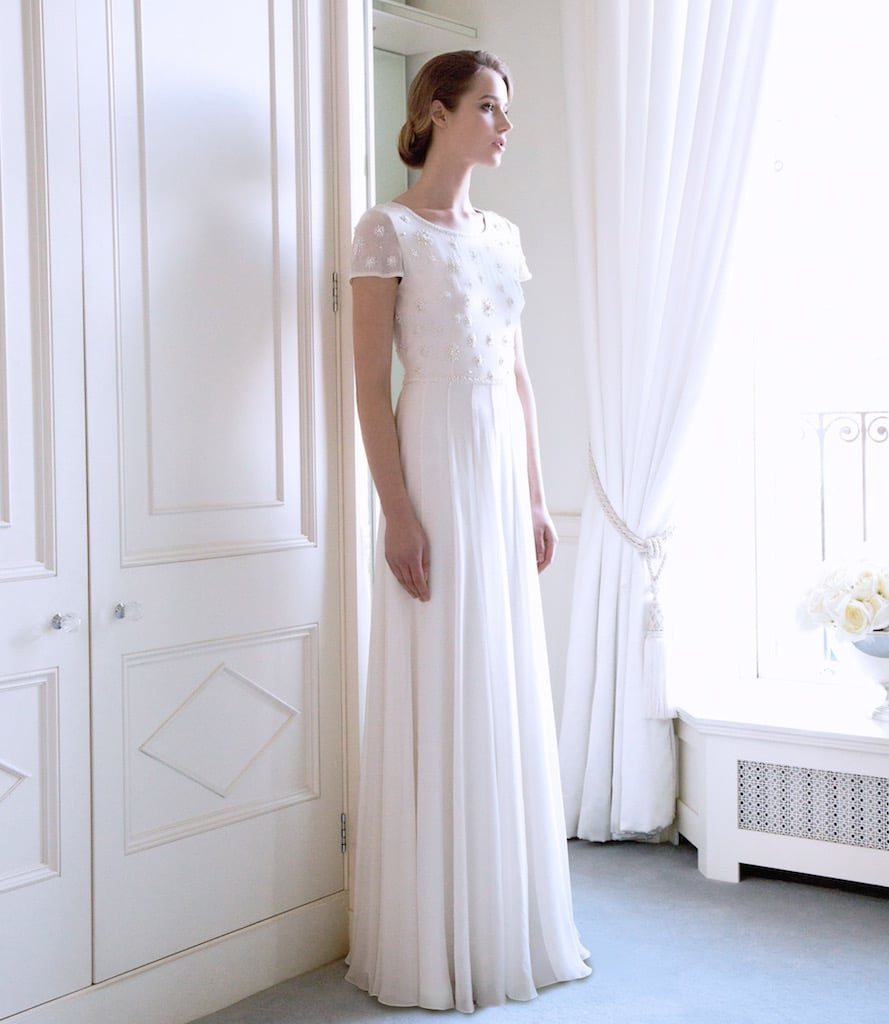 The 'Sissi' Silk Georgette Bridal Gown with Pearl Starburst Encrusted Bodice €3995 invites the spiky texture of white Frilled Tulips or a bouquet of Roses with soft, grey foliage.