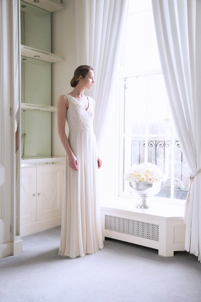 The 'Sophie' Ivory Silk Bridal Dress with Swarovski Encrusted Upper Basque €5500 welcomes the textured heads of white Hydrangea.