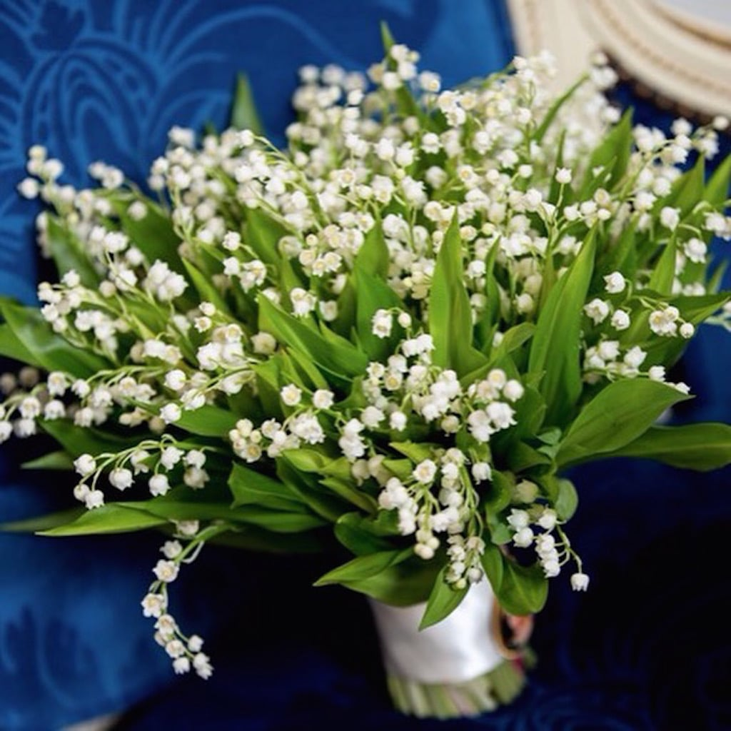 Bridal bouquet of Lily of the Valley designed by Neill Strain
