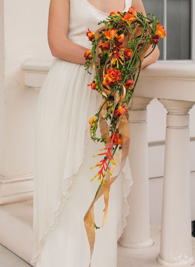 Bridal bouquet with Freesias and Bromeliad designed by Neill Strain Floral Couture