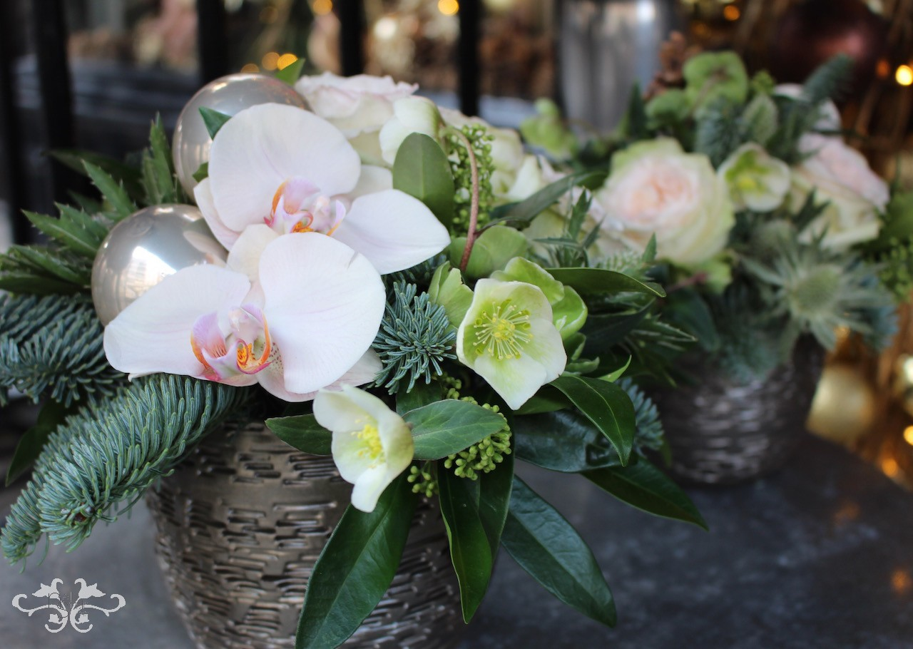 Floral arrangements with seasonal flowers, foliage and a touch of sparkle for the festive season by Neill Strain Floral Couture London