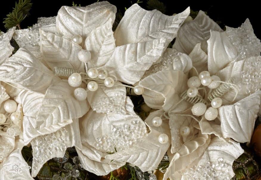 Luxury white Poinsettias, sparkling and glistening.