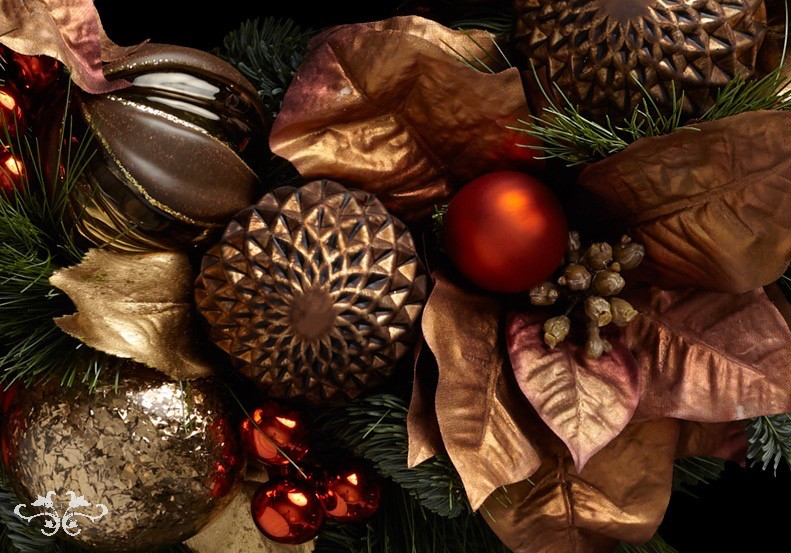 Dark tones and rich textures produce an organic yet delightfully luxurious look to Christmas decorations.
