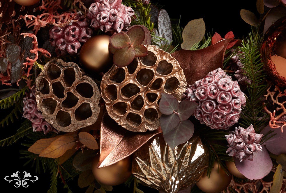 An eclectic mix of plant material along with festive baubles.