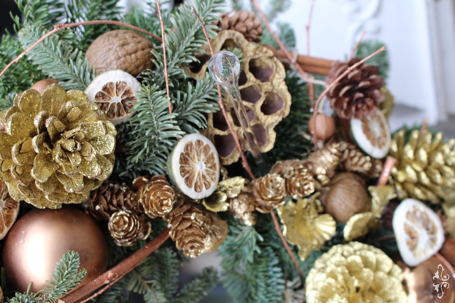 Natural and gold sprayed plant material enhanced with delicate hand-blown glass ornaments.