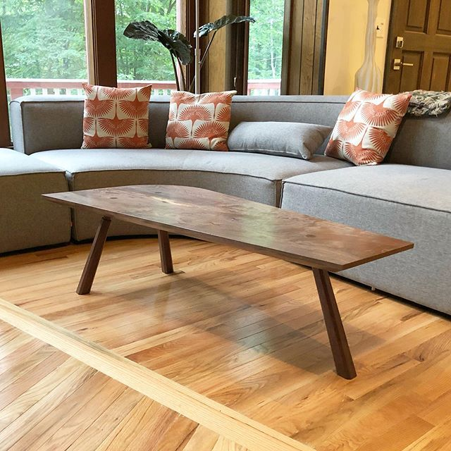 This is a great example of when a custom design is the only good option. This coffee table was created from one raw walnut slab. One corner was rounded to match the curve of the couch. The top tapers to follow the pattern in the hardwood floor. A great piece for great clients.