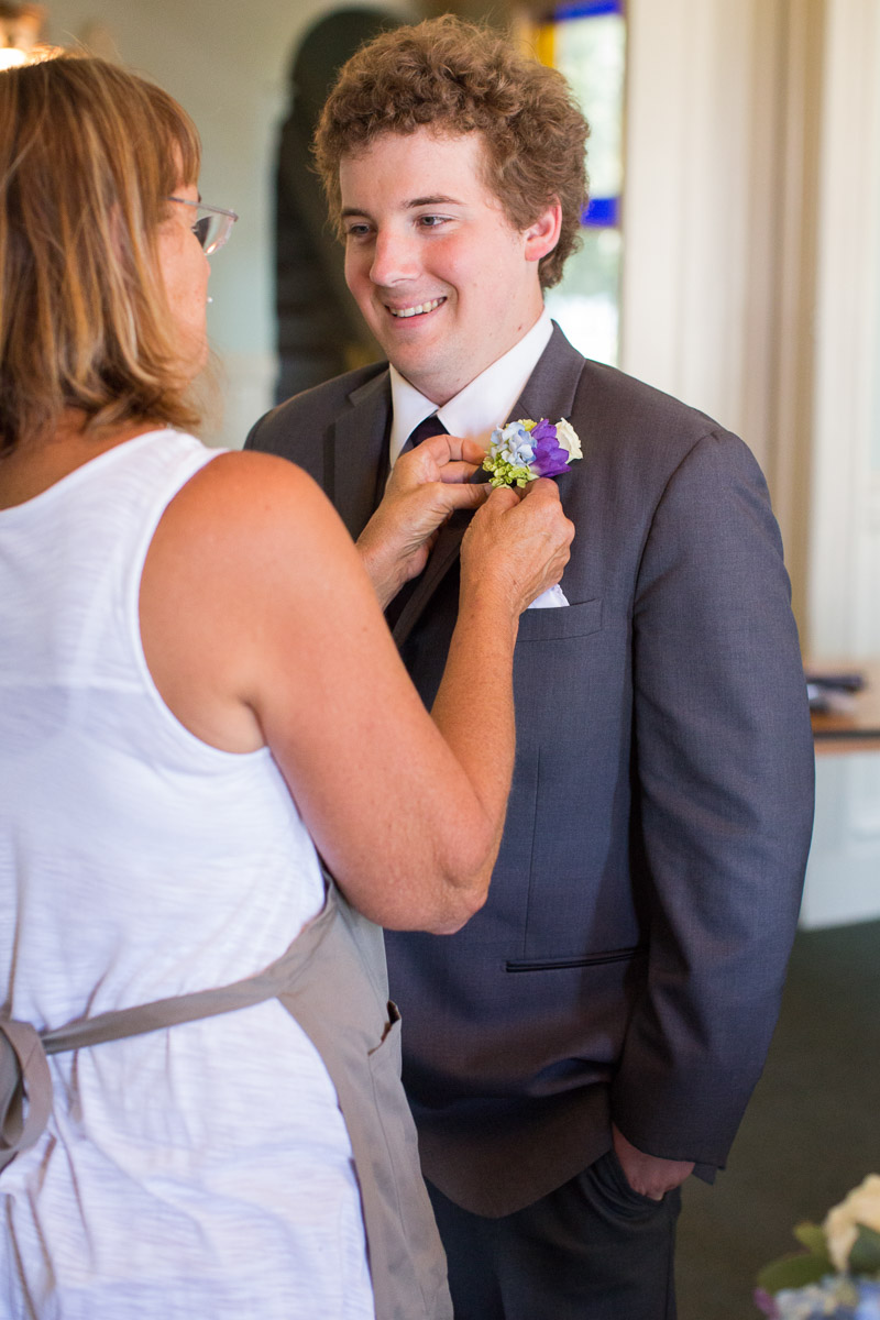 putting on a boutonniere