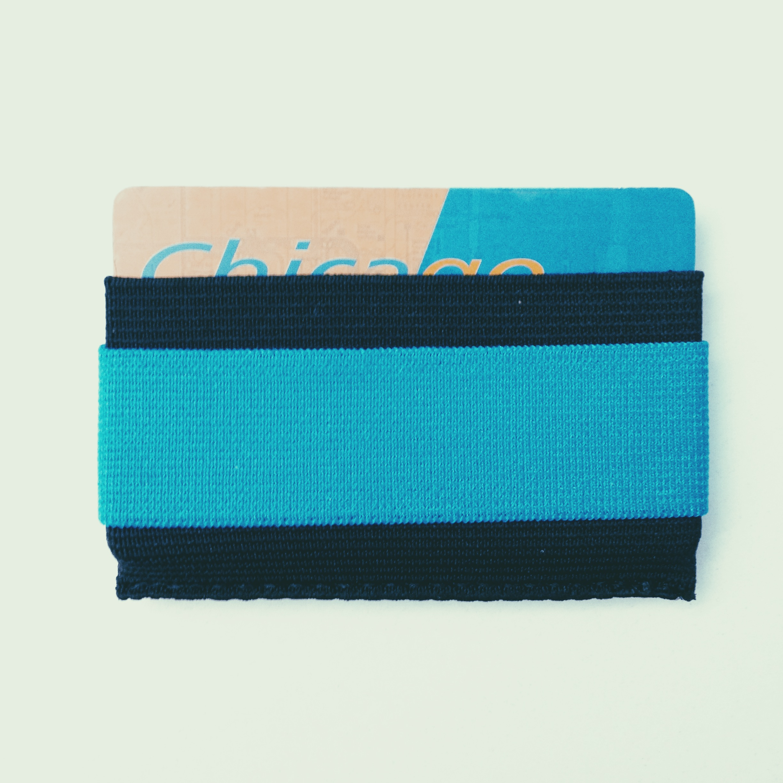 Snapback Slim wallet with blue elastic cash strap.