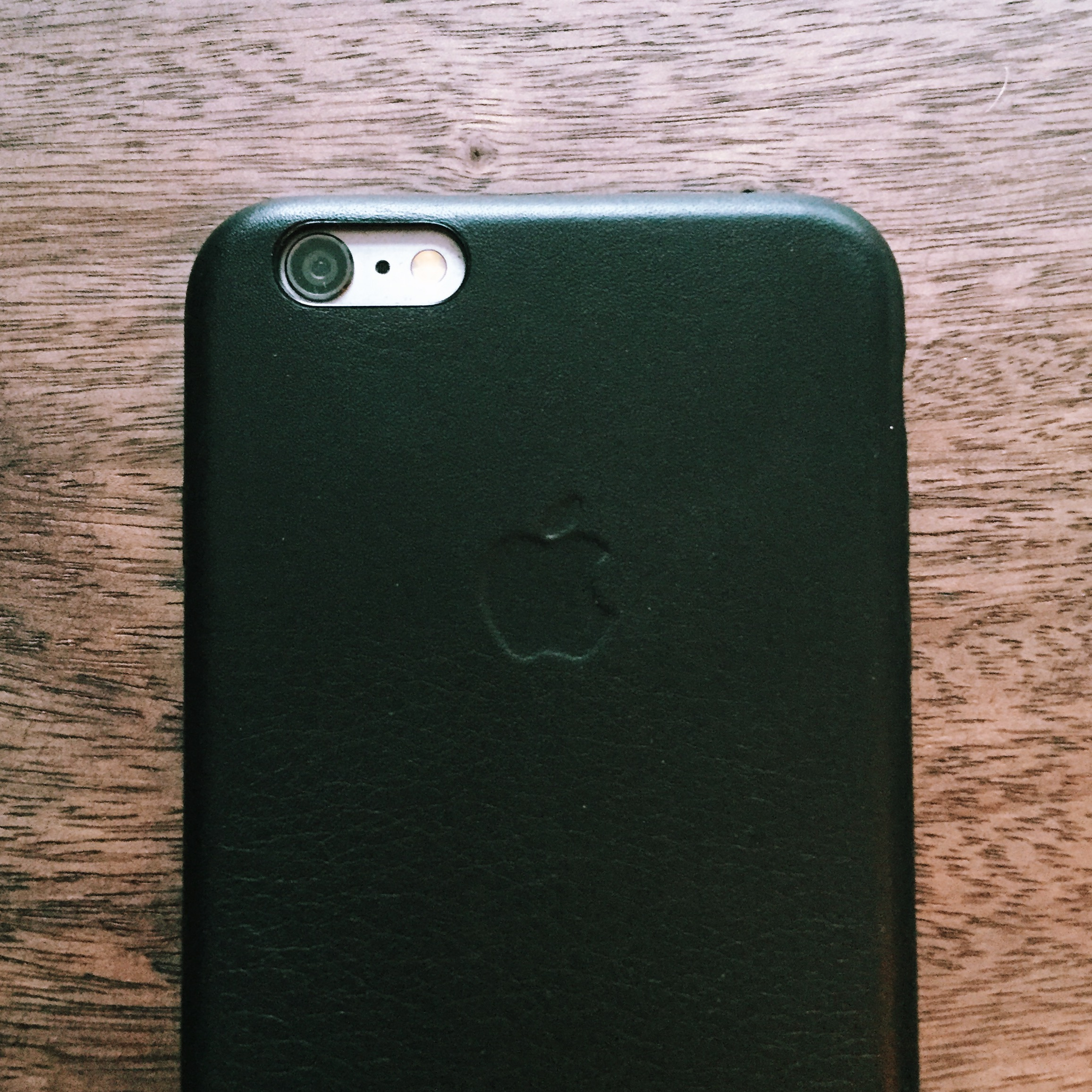 back of iphone 6 plus with black apple leather case