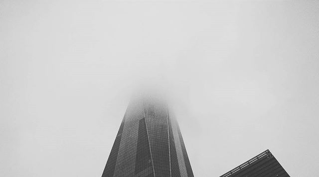 One World Trade Center disappearing into the fog #nyc