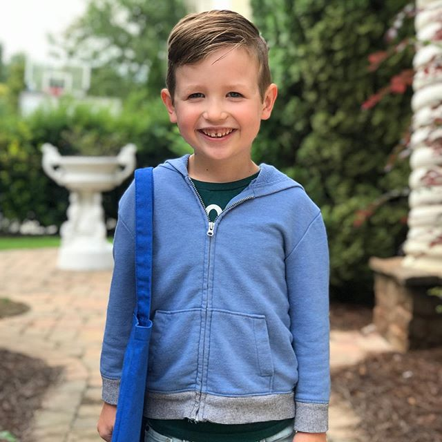 Justice is really growing up too fast. He headed off to his first day of Kindergarten Monday and had a great day. He loves school so much. He also lost his first tooth Sunday night right before his first day. I'm loving his new smile! Go Justice Go!!