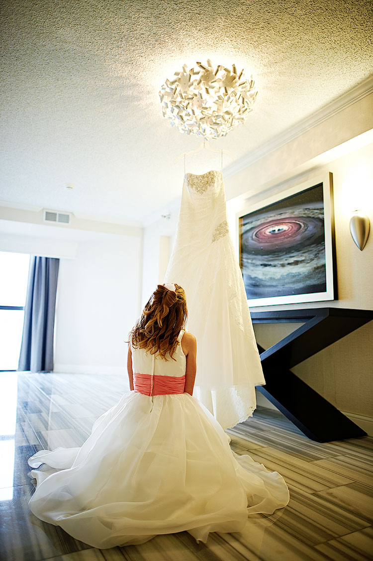 Alee contemplating her mother's dress.