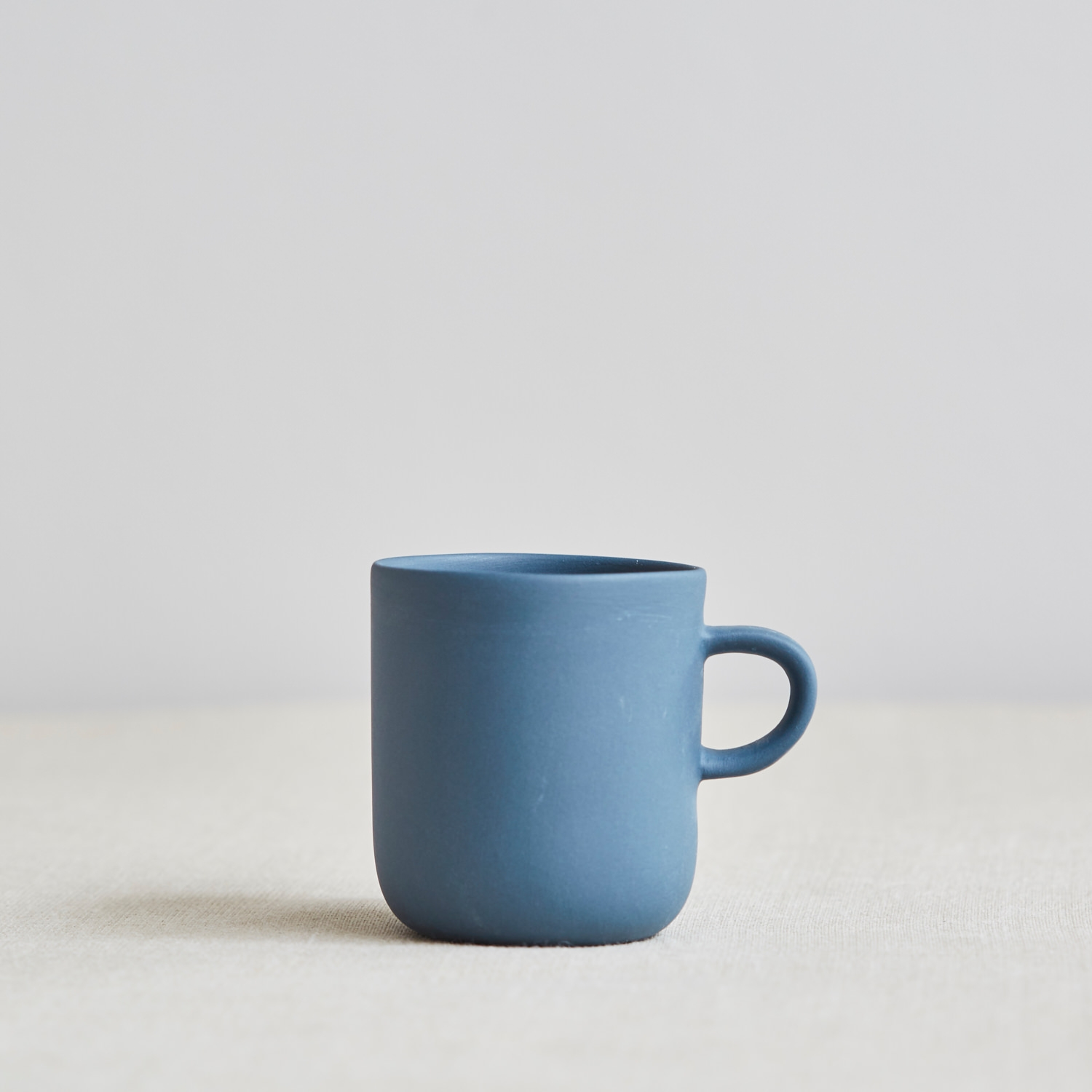 Product - In most cases I recommend we shoot your individual products on a plain background/surface. This could be a combination or materials (see Sue Pryke mug with linen surface and grey wall) or an infinity curve of plain paper such as white or light grey. See gallery below for more examples.