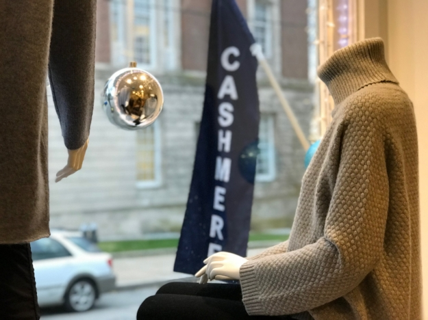 Until Soon Cashmere sweater in store front window