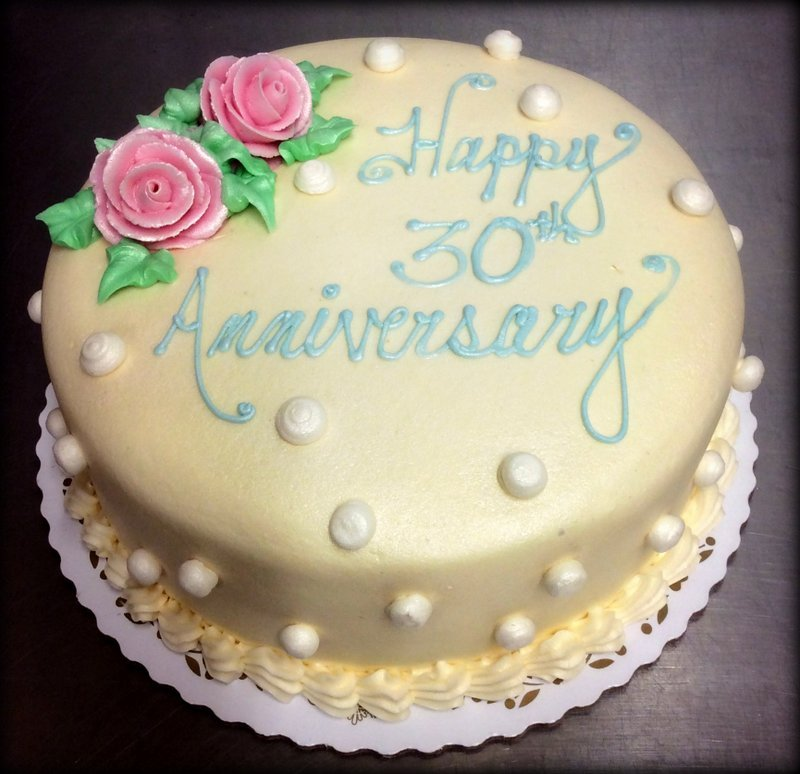 Round Anniversary Cake with Polka Dots and Flowers