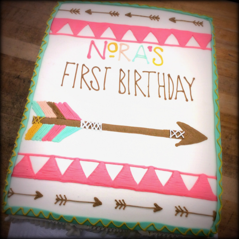 Girl's First Birthday Cake with Arrow Decorations