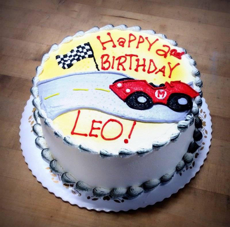 Round Cake with Race Car Decoration