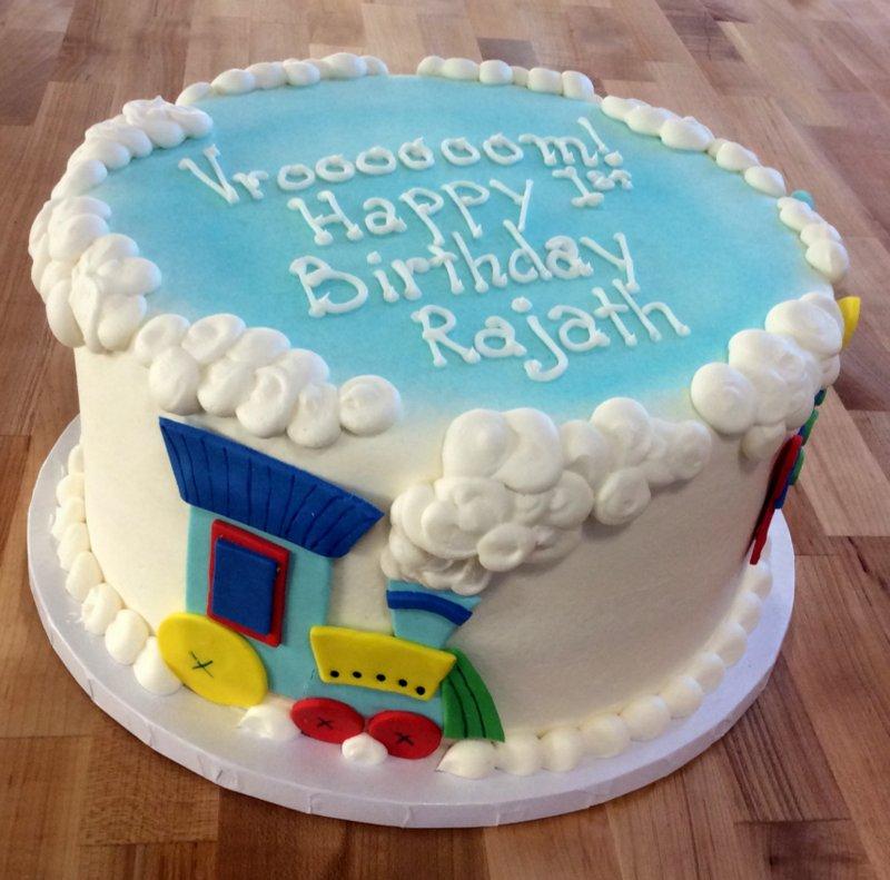 Round Birthday Cake with Fondant Vehicles