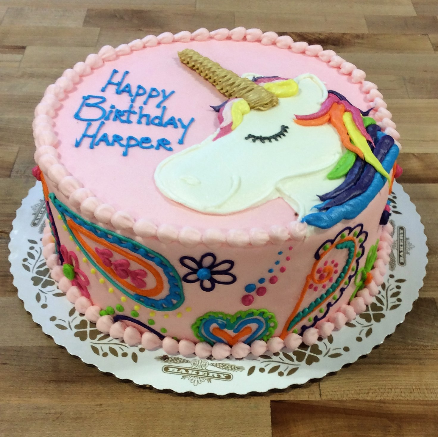 Pink Cake with Unicorn and Paisley Decorations