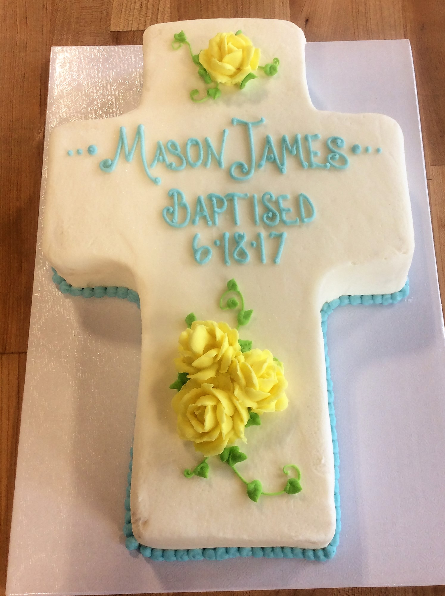 Cross Shaped Cake with Yellow Roses