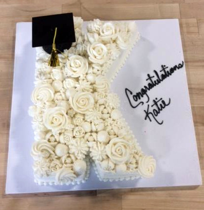 Letter Shaped Flower Covered Cake.jpg