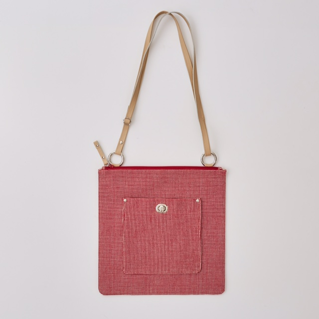 No. 1512 £95  Flat zip-top shoulder / cross-body bag. Adjustable, detachable leather strap. Lined with cream and red dotty fabric. One interior pocket.  30 x 30 295 g
