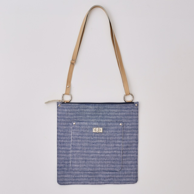 No. 1513 £95  Flat zip-top shoulder / cross-body bag. Adjustable, detachable leather strap. Lined with blue and white striped ticking fabric. Large interior patch pocket.  30 x 30 265 g