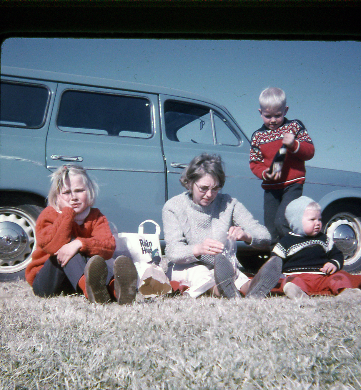 A road trip with the family - everybody in homemade knitted sweaters