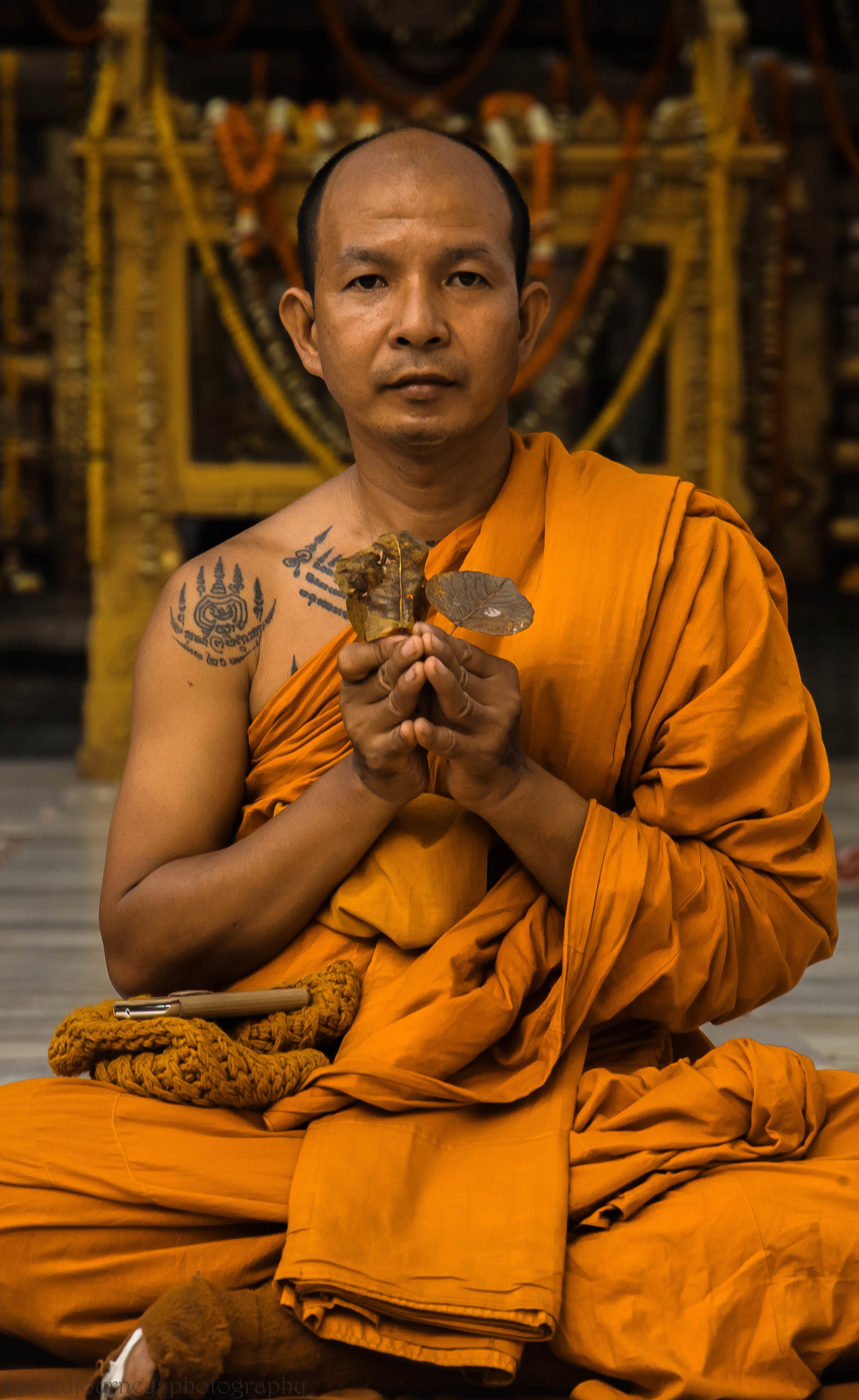 Thai monk with       Bodhi Leaves        Bodhgaya