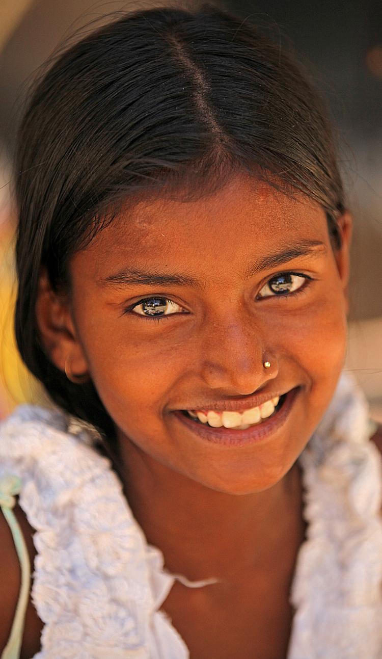 children girl bright eyes Triveni Ghat Rishikesh.jpg