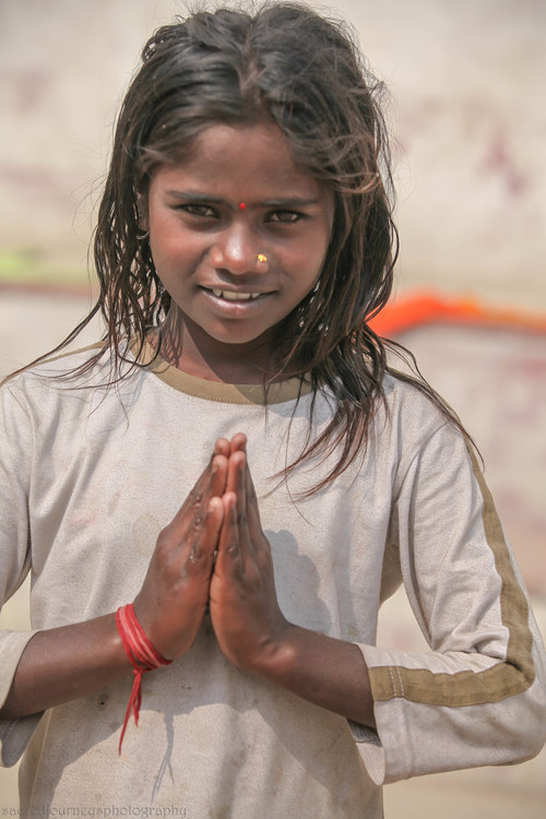 children child looking straight prayer pose Varanasi.jpg