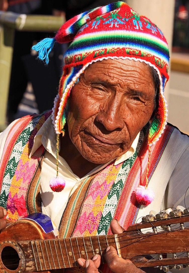 Peru W man and guitar Lake Titicaca Puno Peru.jpg