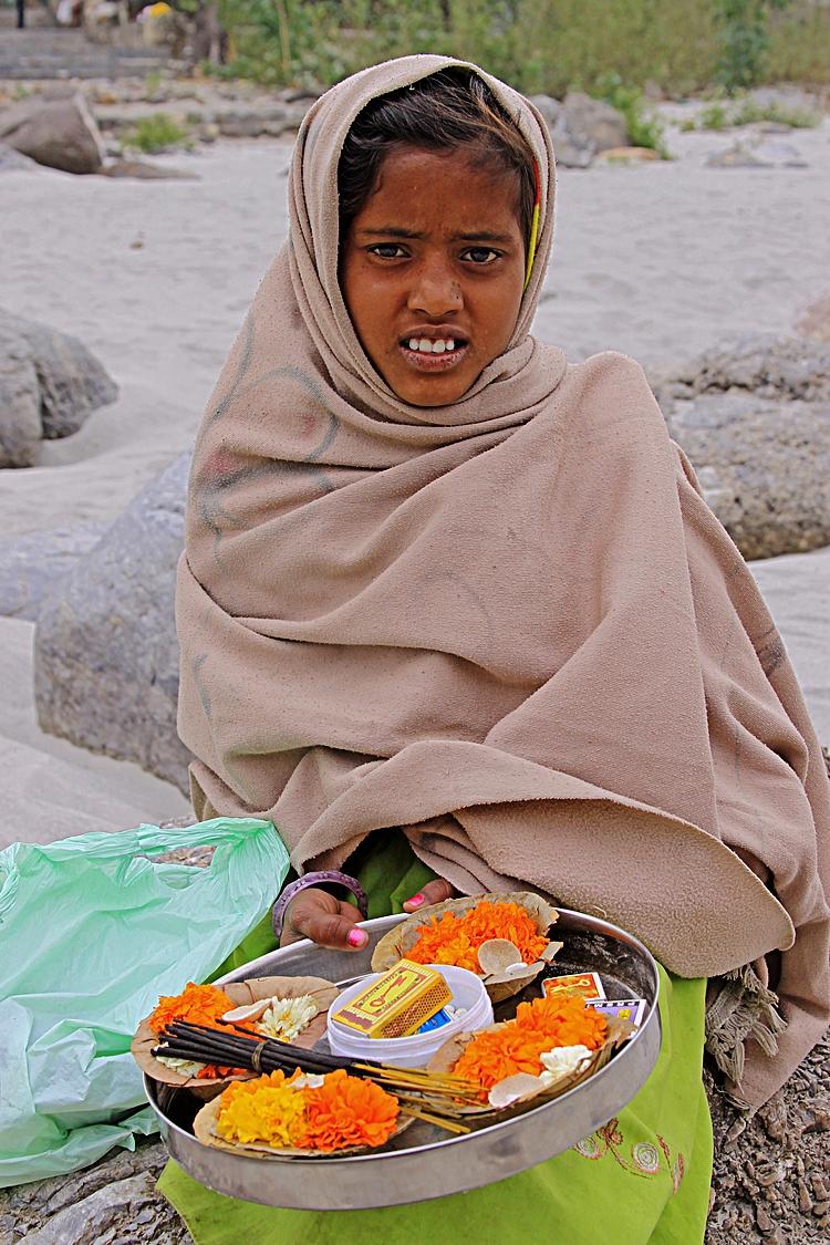 children young girl selling Ganga Rishikesh.jpg