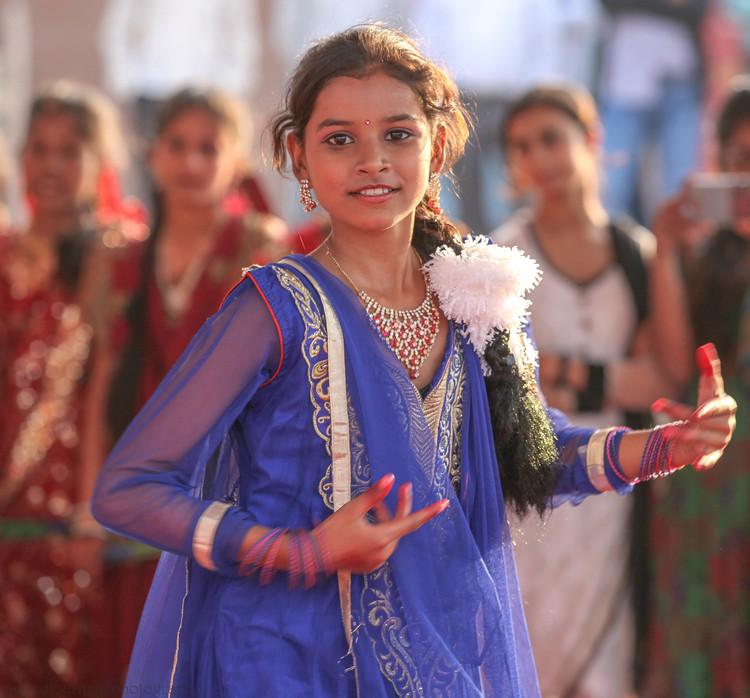 website girl in blue dancing facing varanasi.jpg