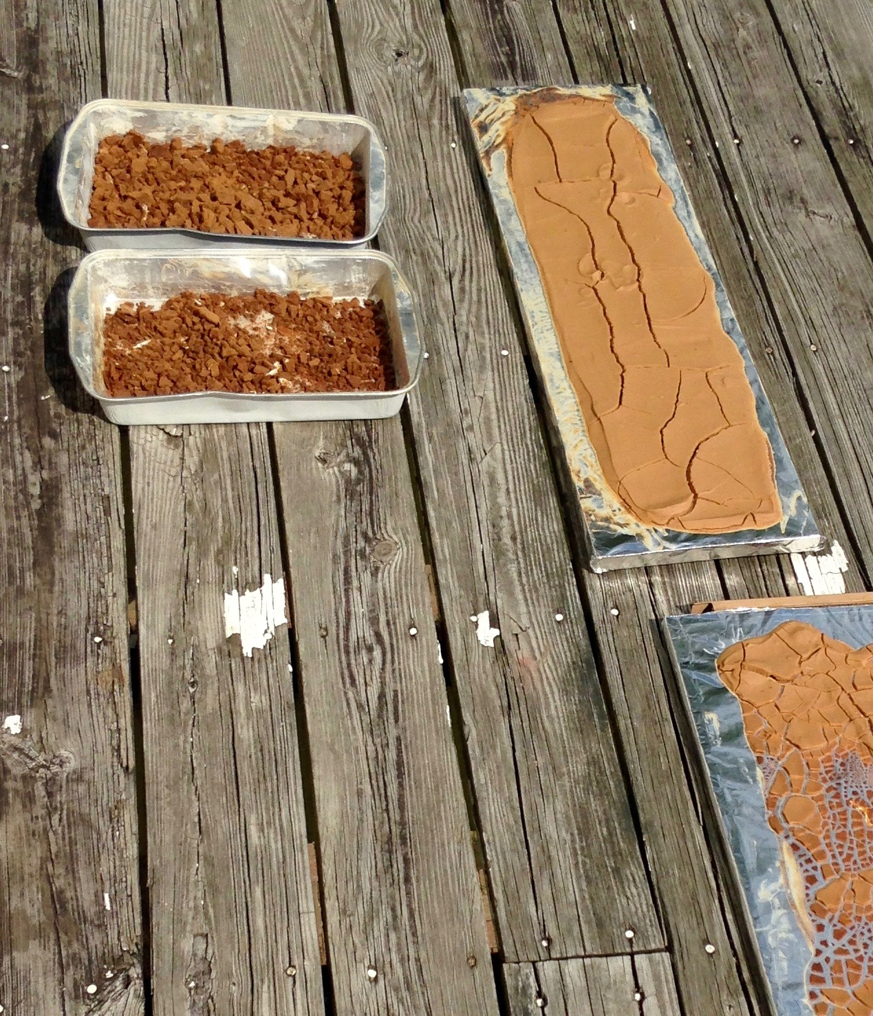 The resins, cooked, dyed, washed, and drying in the sun before being made into varnish.