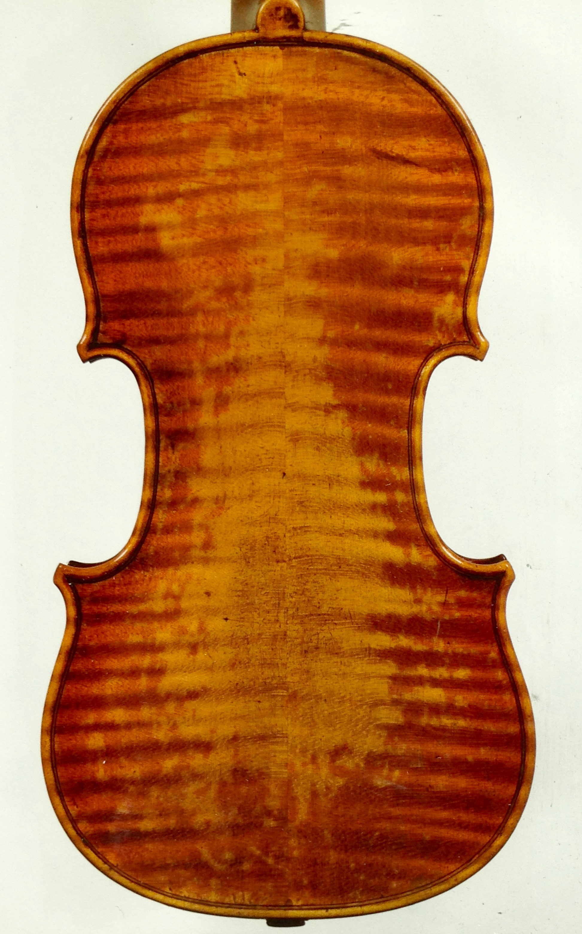 The back of a Stradivari violin. The natural wear of the varnish creates a gorgeous patina that can't be reproduced artificially.