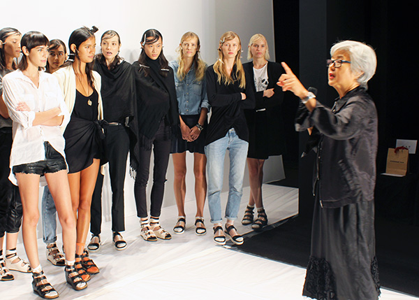 Lynne O'neill providing instructions to the models on runway etiquette, walk, and timing.