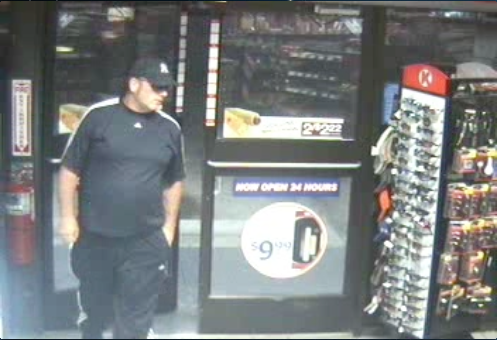 PHOTO:  Still photo taken from security camera footage.    The suspect is a white male in his late 40s to early 50s, approximately 6 feet tall, heavyset with a scar on his lip (right side).  The male was wearing a blue/white short sleeve Adidas shirt with blue/white striped pants. The male had on sunglasses and a blue baseball cap with a white emblem on the front of it (possibly the New York Yankees emblem).  (Photo Courtesy of Cape Coral Police Department)