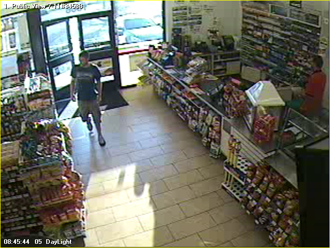 """PHOTO: Surveillance footage of a suspect involved in a string of retail thefts of cigarettes.    The suspect appears to be a white male between 25-35yrs of age, with short strawberry-blonde/brown short hair, slight beard, approximately 5'6""""-6', 150-170lbs, wearing distinctive tennis shoes (possibly Air Jordans, white on top and black on bottom), and thin to lean build.  In other store videos, he's wearing an orangish-red NY baseball hat and flipflops or slides.   (Photo Courtesy of Cape Coral Police Department)"""