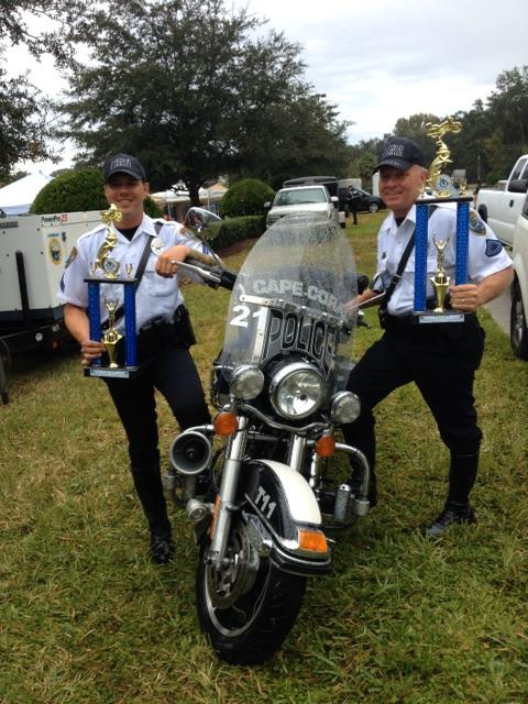 PHOTO: CPL Schilke III and CPL C. Hartzell pose by a Cape Coral Police Department harley davidson road King with their trophiesfor a quick photo at this weekend's Motor Officer Rodeo.. (Photo Courtesy of Cape Coral Police Department)