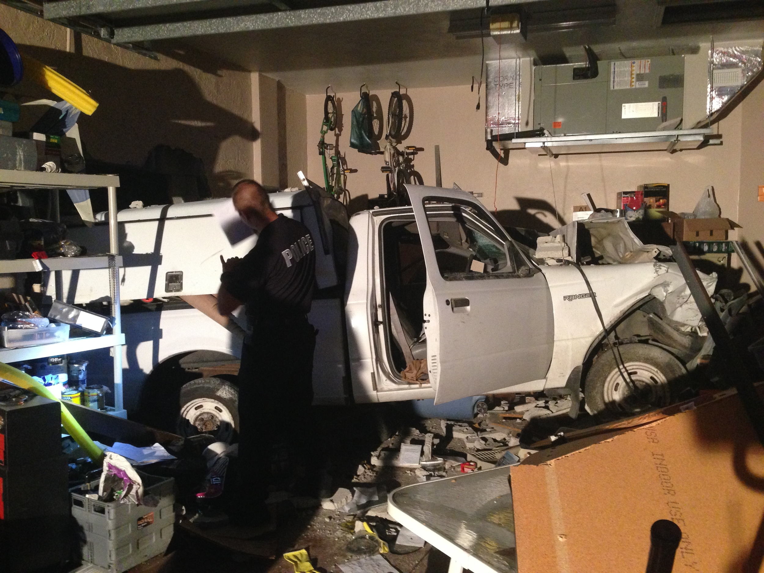 PHOTO: On December 19, 2013 at 4:27 PM, Cape Coral Police Department responded to a SW Cape Coral home where a driver crashed his white pickup truck into a home. (Photo Courtesy of Cape Coral Police Department)