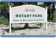 Image of the park entrance sign at Rotary (Glover Bight) Park at 5505 Rose Garden Rd., Cape Coral, FL.