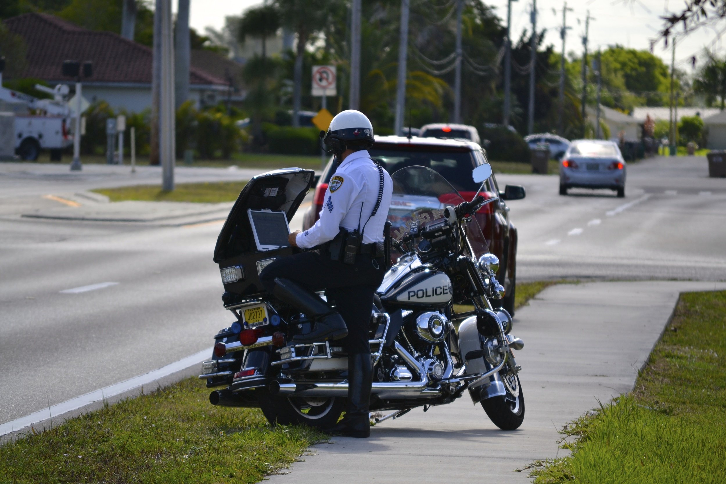 PHOTO: A Cape Coral Police Department Motorcycle officer conducts a traffic stop. (Photo Courtesy of Cape Coral Police Department)