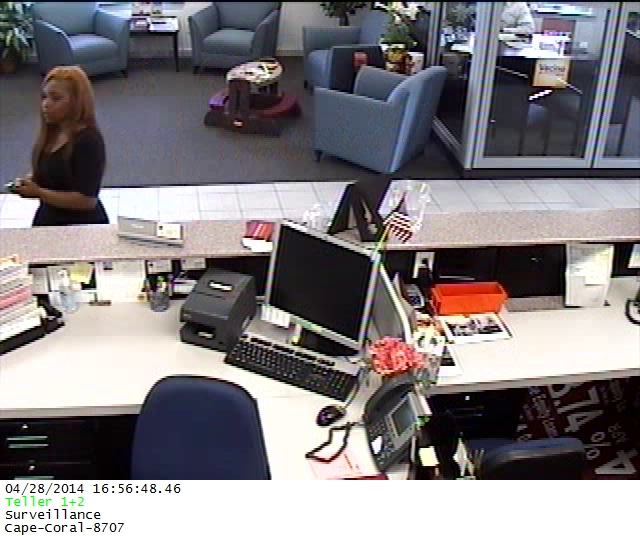 PHOTO:  Surveillance camera footage shows two check fraud suspects-  a B/F with long reddish hair, and a B/M wearing a NJ Nets baseball cap.  (Photo Courtesy of Cape Coral Police Department)