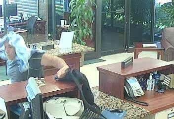 """PHOTO: Stills taken from surveillance cameras show a bank robbery suspect. W/M (possibly Hispanic or Arab), 5'10""""-6'00"""", 220-230 lbs, BLK pants, BLK shirt, clean shaven, 35-40 years of age. (Photo Courtesy of Cape Coral Police Department)"""