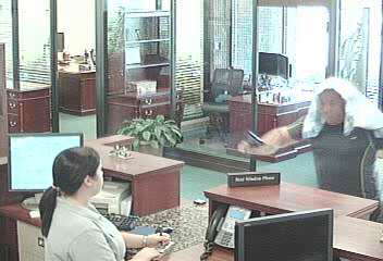 """PHOTO: Stills taken from surveillance cameras show a bank robbery suspect. W/M (possibly Hispanic or Arab), 5'10""""-6'00"""", 220-230 lbs, BLK pants, BLK shirt, clean shaven, 35-40 years of age. (Photo Courtesy ofCape Coral Police Department)"""