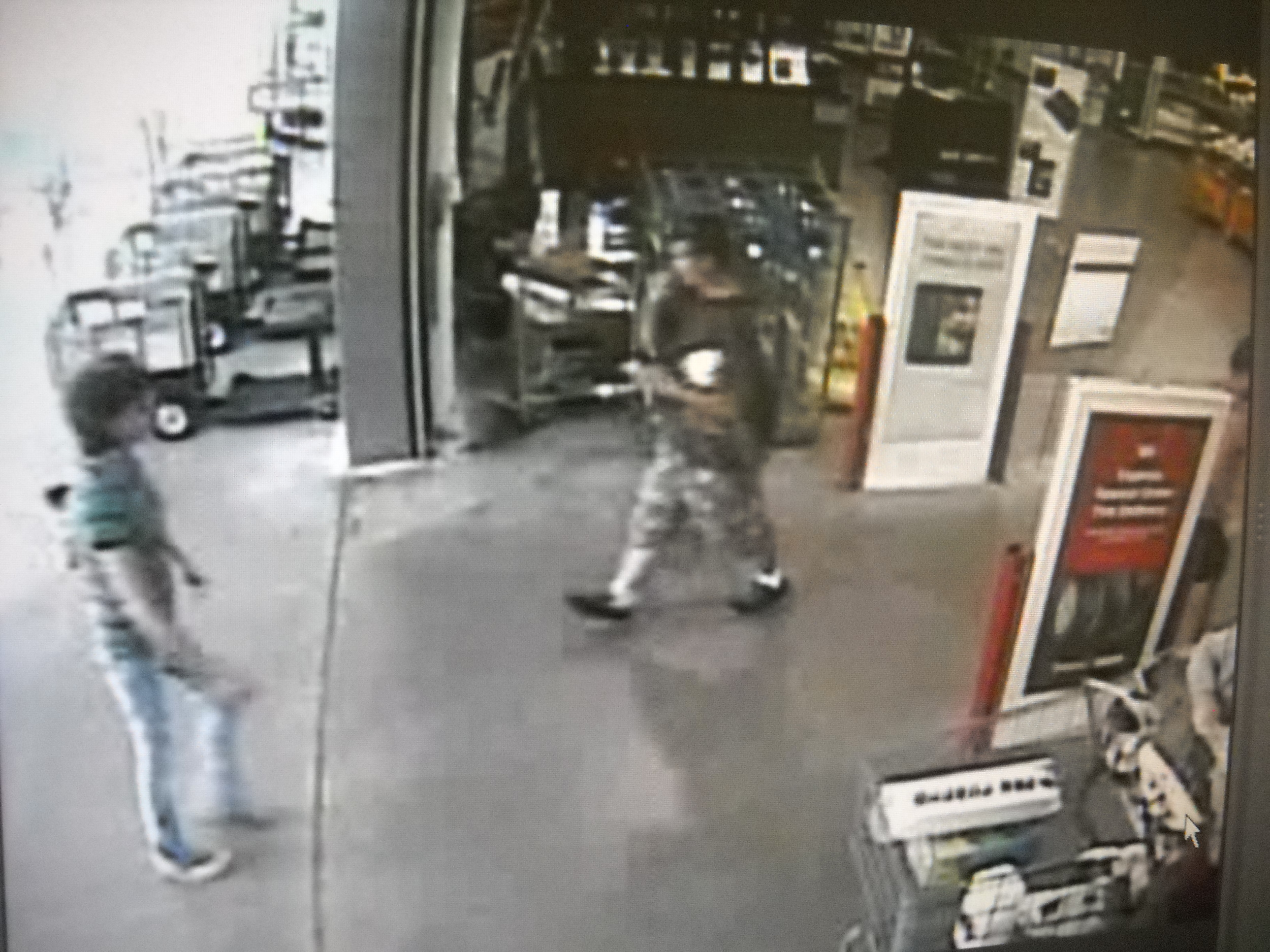 """PHOTO: Video surveillance shows a white male in his mid-twenties to early thirties, with a thin build, and average height (5`9""""- 6`0""""). The male had short brown hair and was wearing sunglasses on top of his head. He was wearing a light gray or brown t-shirt and long camouflage shorts of the same color with white socks and black shoes.. (Photo Courtesy of Cape Coral Police Department)"""