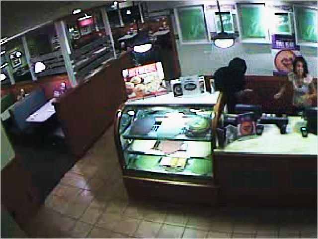 PHOTO: Armed Robbery suspects-Both suspects were completely covered from head to foot, making it extremely difficult to obtain accurate descriptions from witnesses. The first suspect wore a black, long-sleeved shirt, and had a silver revolver. The other suspect had on a white long-sleeved shirt and socks over his hands. (Photo Courtesy of Cape Coral Police Department)